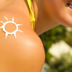 A sun made with suncream at the shoulder (shallow dof)