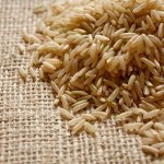 5564503 - brown rice on a textile background