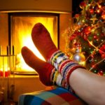11557624 - girl resting in a home with a burning fireplace and christmas tree
