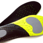 68612123 - orthopedic insoles for athletic shoes on white background
